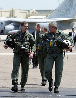 George W. Bush arrives in a flight suit aboard the USS Abraham Lincoln, May 1, 2003